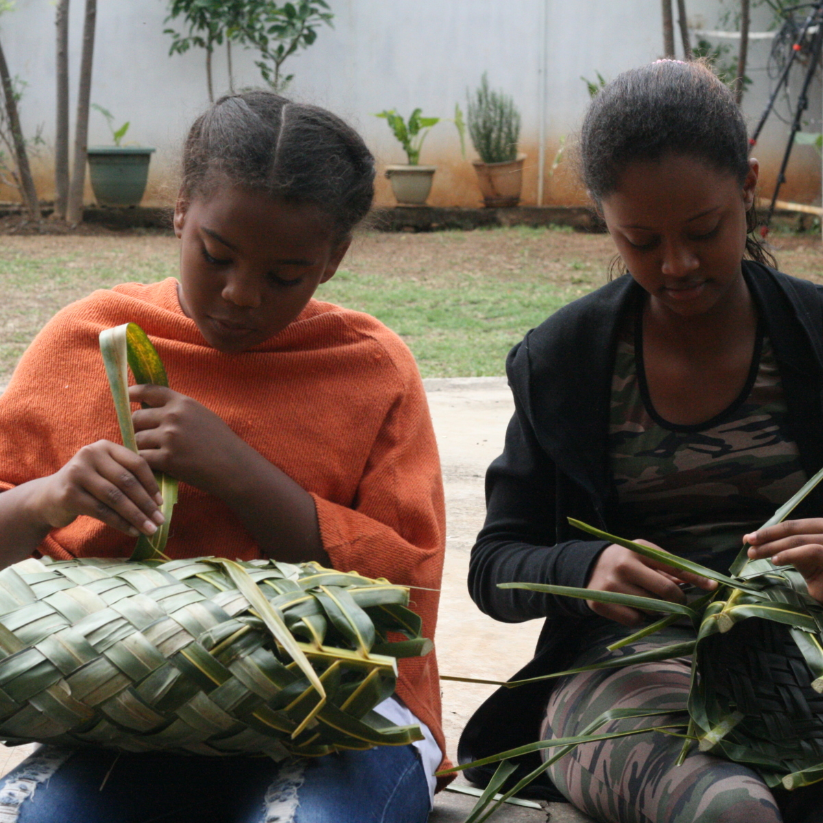 Basket weaving with coconut fronds